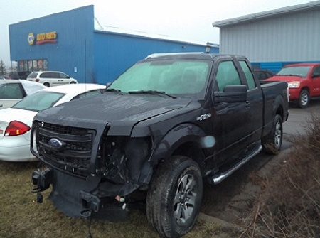 Black Ford Pick Up Truck-Before Repairs